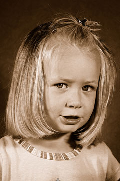 a sepia portrait of a female child